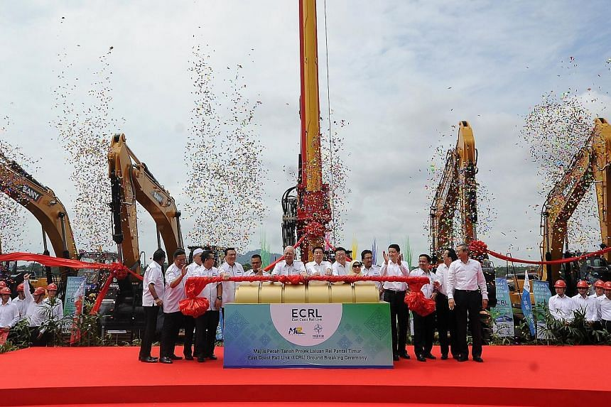 Malaysian Prime Minister Najib Razak (seventh from left) with Chinese State Councillor Wang Yong (centre) at the ground-breaking ceremony for the railway project linking Malaysia's east and west coasts on Wednesday. China is funding the 620km-long ra