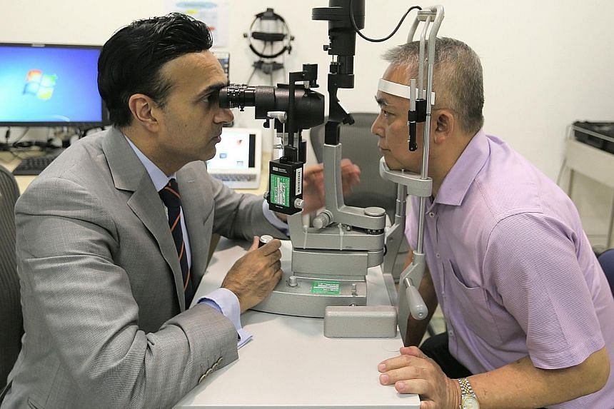Associate Professor Jodhbir Mehta, head and senior consultant at SNEC's corneal and external eye disease department, with Mr Tan Beng Wee, who lived with pterygium for 30 years before going for Flaps last year.