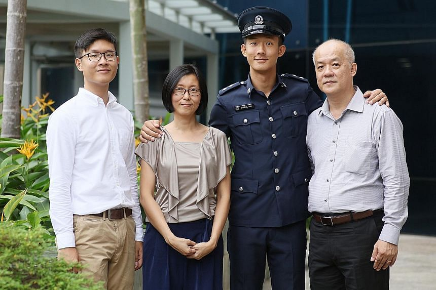 """Inspector Gabriel Tan Jin Hsi with brother Samuel, mother Pearly Chuang and father Tan Yok Khoon. """"As a child, Gabriel did not like to read, but whenever we went to the library, he would head straight for the detective stories... He's always been int"""