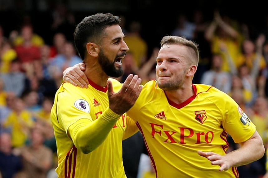Watford's Miguel Britos (left) celebrating his dramatic injury-time equaliser with Tom Cleverley against Liverpool.