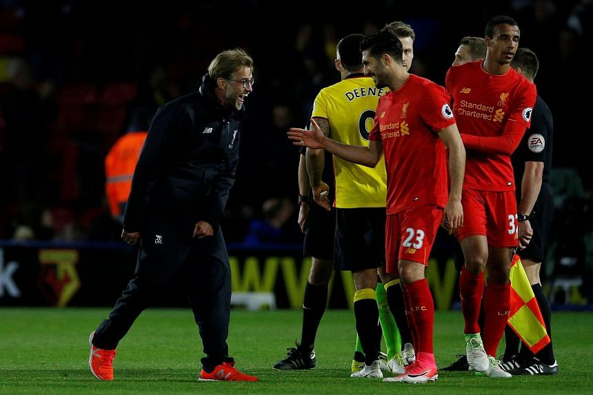 Liverpool manager Juergen Klopp celebrates with Emre Can after the match.
