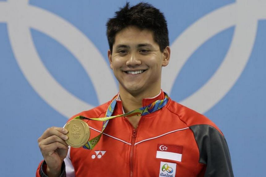 Joseph Schooling posing with his gold medal from the Rio 2016 Olympic Games men's 100m butterfly final at the Olympic Aquatics Stadium in Rio de Janeiro, Brazil, on Aug 12, 2016.