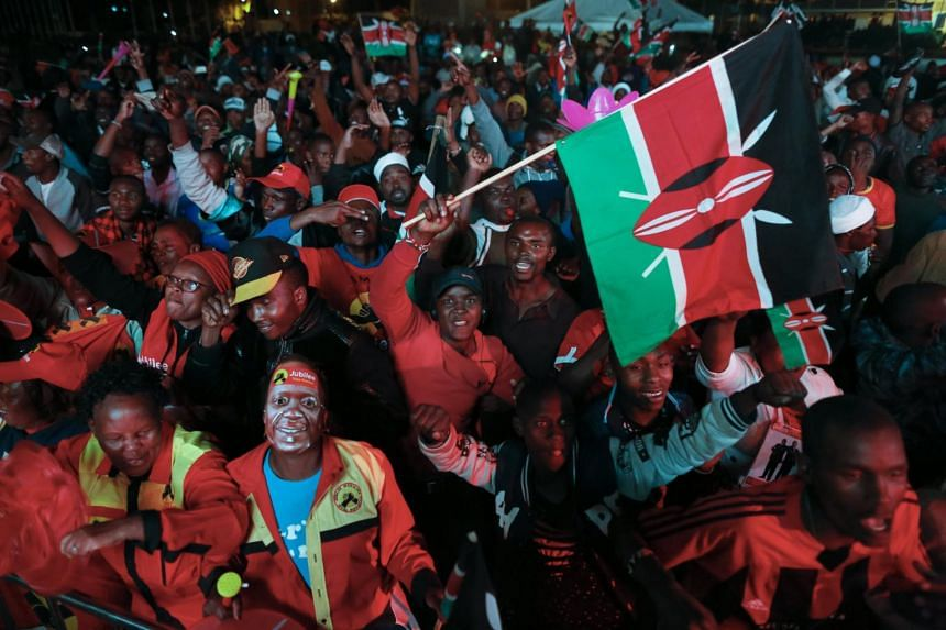 Supporters of President Uhuru Kenyatta cheer as they celebrate after he was declared the winner of the presidential election in Nairobi, Kenya, on Aug 11, 2017.