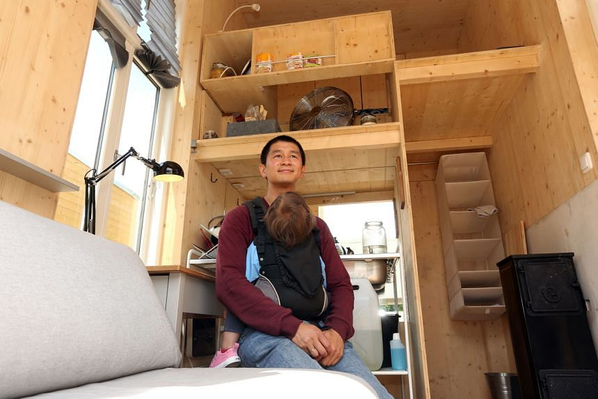 Mr Van Bo Le-Mentzel (left), founder of Tiny House University, inside one of the project's houses.