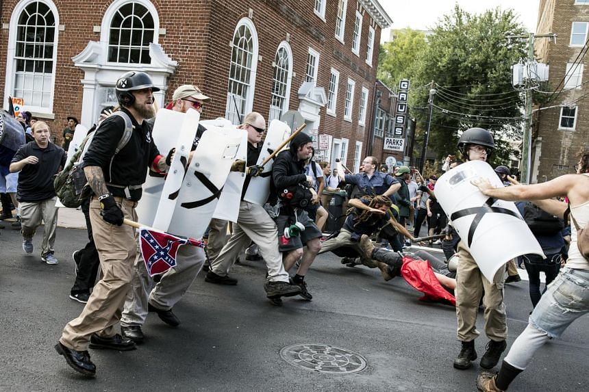 White nationalists and counter protesters clash on the streets of Charlottesville on Aug 12, 2017.