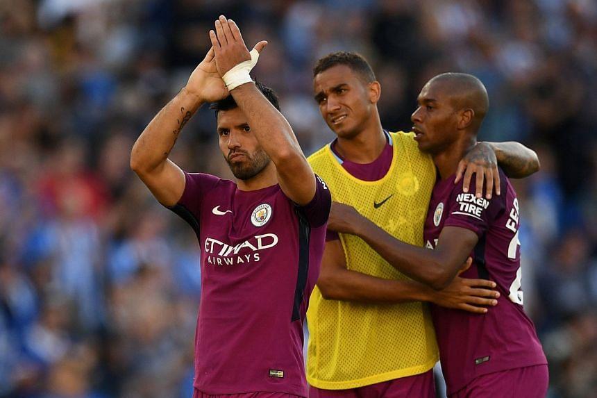 Manchester City's Sergio Aguero applauds fans after the match.