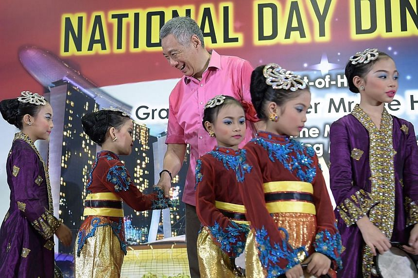 "Prime Minister Lee Hsien Loong meeting young performers at the Teck Ghee National Day dinner yesterday. Noting that productivity is rising, Mr Lee said: ""This is encouraging... We are able to upgrade our economy, and we are able steadily to improve"