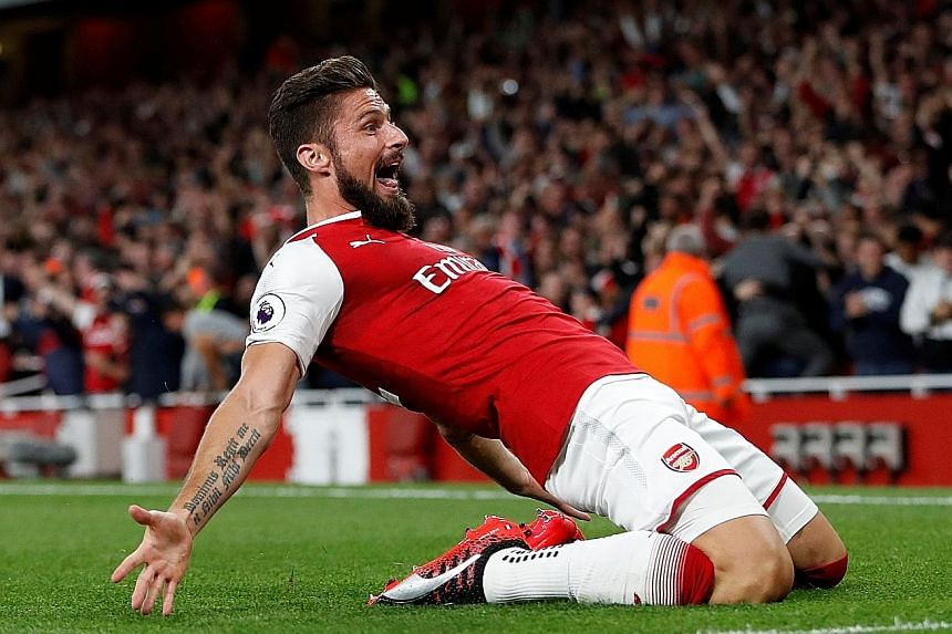 A delighted Olivier Giroud after his 85th-minute header hit the bar and bounced behind the line before Kasper Schmeichel could club it away.