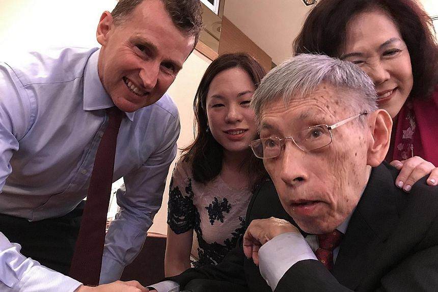 Former Member of Parliament for Potong Pasir Chiam See Tong posing for a wefie with his wife Lina, daughter Camilla and rugby referee Nigel Owens at a charity gala dinner last night for the sports foundation that bears the veteran politician's name.