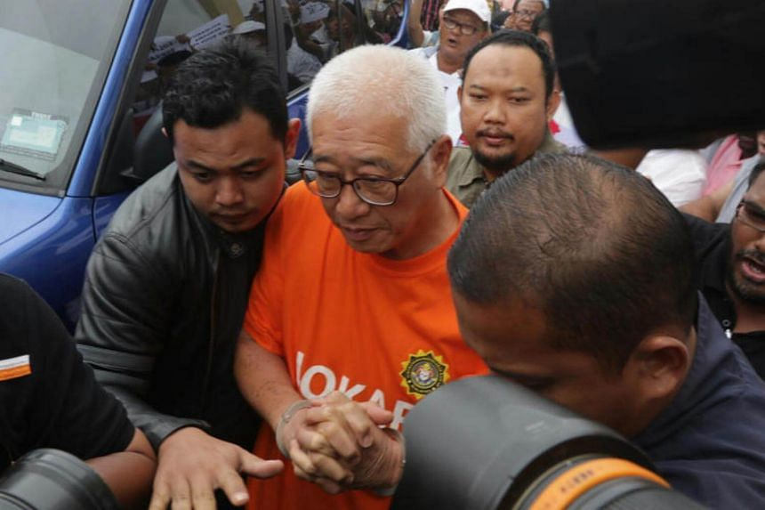 MACC officers escorted Sungai Puyu assemblyman Phee Boon Poh to George Town court for remand in Penang.