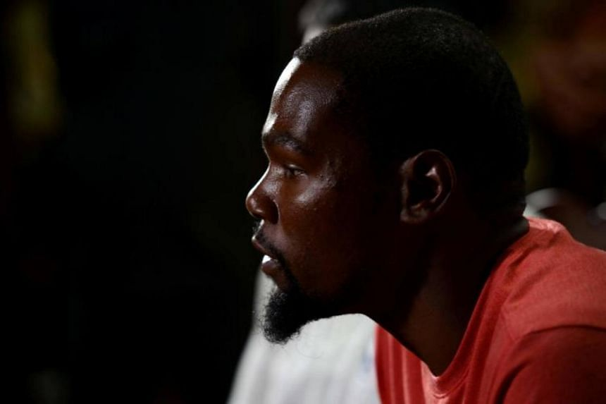 American basketball player for Golden State Warriors Kevin Durant looks on during a press conference at the NBA academy in Greater Noida, a suburb of New Delhi on July 28, 2017.