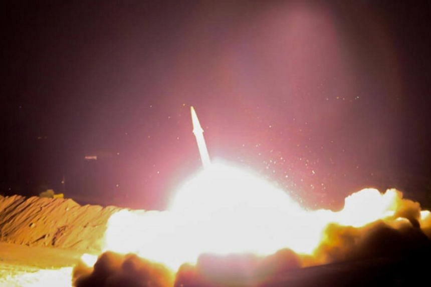 Iranian Revolutionary Guards Corps launching a missile towards ISIS bases in Syria. Iran is increasing funding for its missile programme following US sanctions.