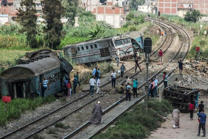 People observing the wreckage of a fatal train collision in Alexandria, on Aug 12, 2017.