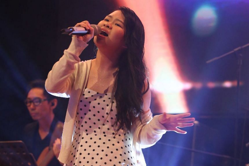 Polytechnic student Joyce Seah, 18, won the solo singing category at the third edition of the National Schools Xinyao Singing and Songwriting Competition. PHOTO: LIANHE ZAOBAO