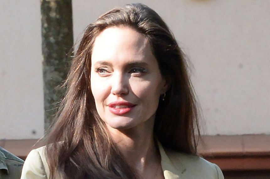 """""""The divorce is off,'' an insider told US Weekly news outlet, which reported that Brad Pitt and Angelina Jolie had a change of heart recently."""