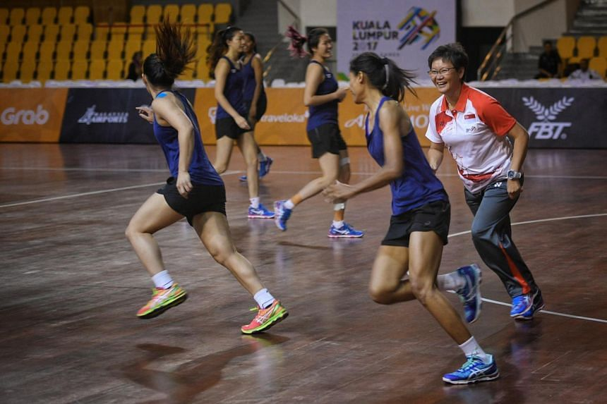 Singapore Netball SEA Games coach Yeo Mee Hong (right) playing a game of catching with the national netball team before training at Juara Stadium Bukit Kiara ahead of the 29th SEA Games in Kuala Lumpur, Malaysia, on Aug 13, 2017.