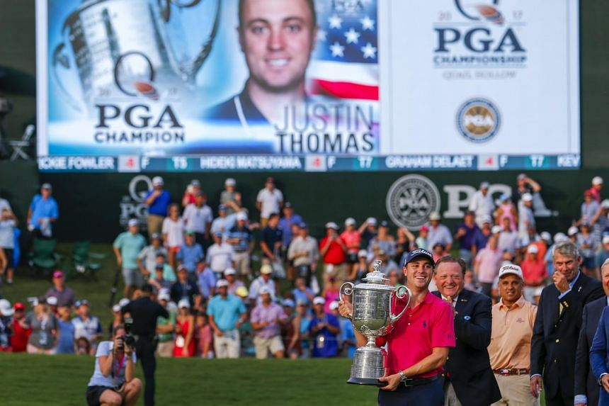 Justin Thomas (right) holding the Wanamaker Trophy after winning the 99th PGA Championship golf tournament, on Aug 13, 2017.