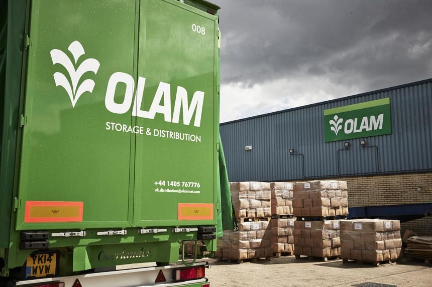 Olam International's warehouse (right) and storage and distribution vans.