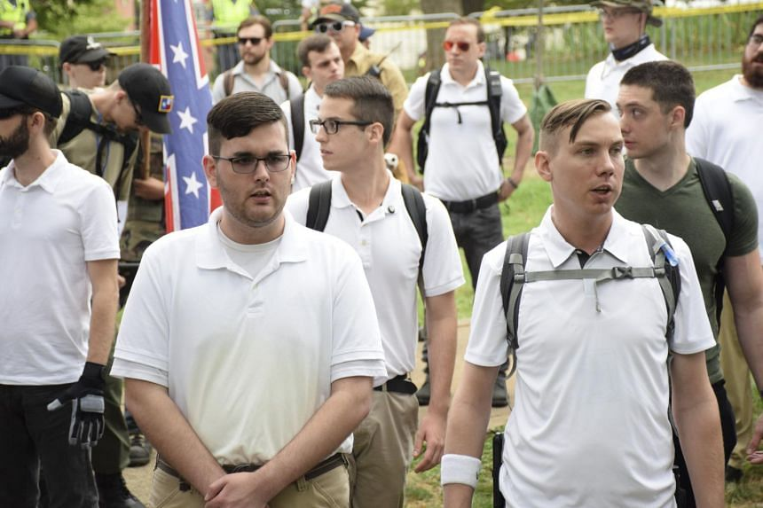 James Alex Fields Jr, left, in a crowd of white nationalists in Charlottesville, on Aug 12, 2017.