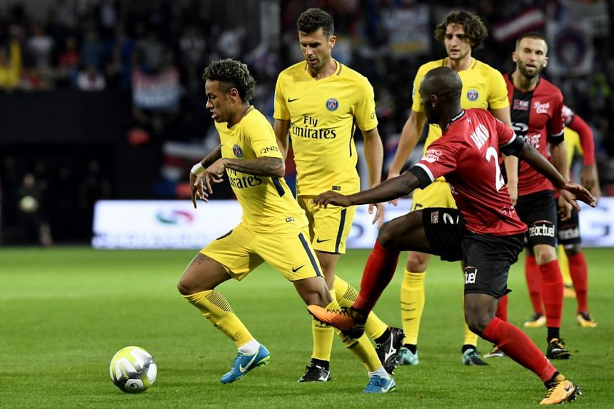 Guingamp's French-Congolese defender Jordan Ikoko (right) vies with Paris Saint-Germain's Brazilian forward Neymar during the French L1 football match, on Aug 13, 2017.