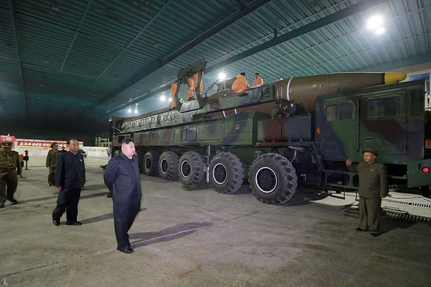 North Korean leader Kim Jong Un inspecting the assembly work of an ICBM which was launched on July 4, 2017.