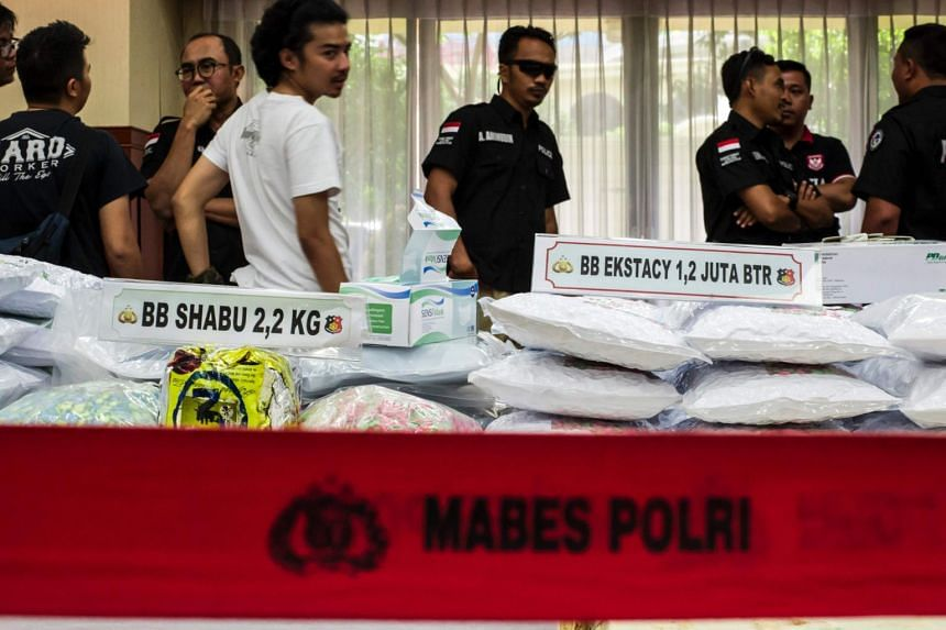 Indonesian narcotics police display seized ecstasy pills during a press conference in Jakarta, on Aug 1, 2017.