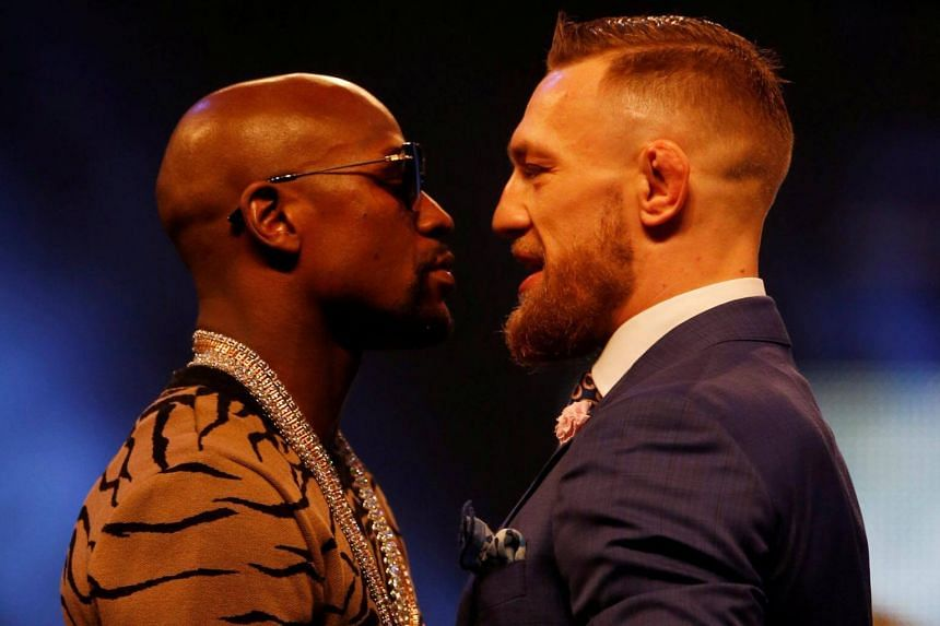 Floyd Mayweather (left) and Conor McGregor at a press conference in London, Britain on July 14, 2017.