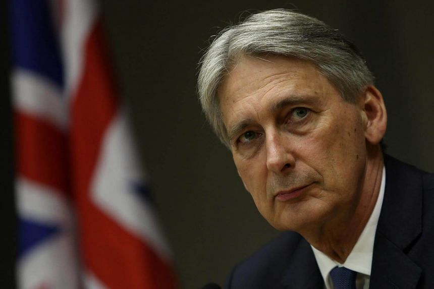 Britain's Chancellor of the Exchequer Philip Hammond attends a meeting in Brasilia, Brazil, on July 31, 2017.