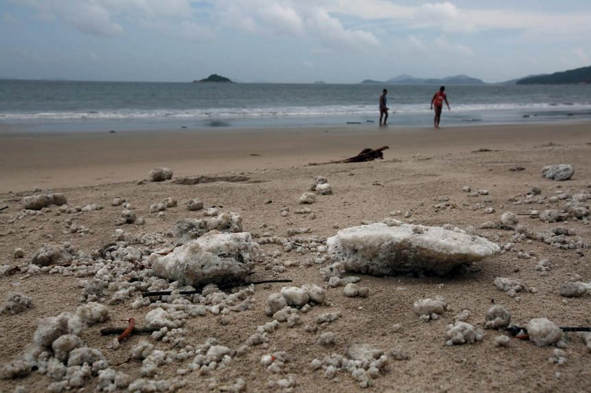 Crystallised palm oil is seen along Cheung Sha beach at Lantau Island in Hong Kong on Aug 9, 2017.