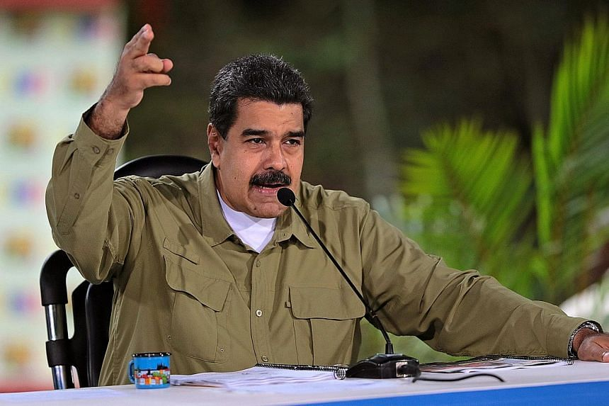 Venezuelan President Nicolas Maduro's Socialist party is facing pressure over a perceived power grab.