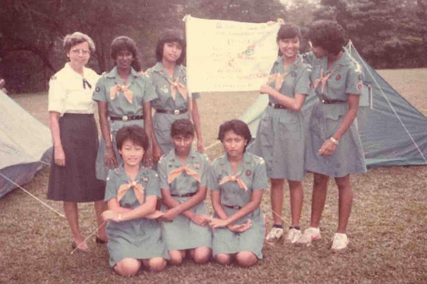 Above: Ms Alvis with some Girl Guides in the 1960s.