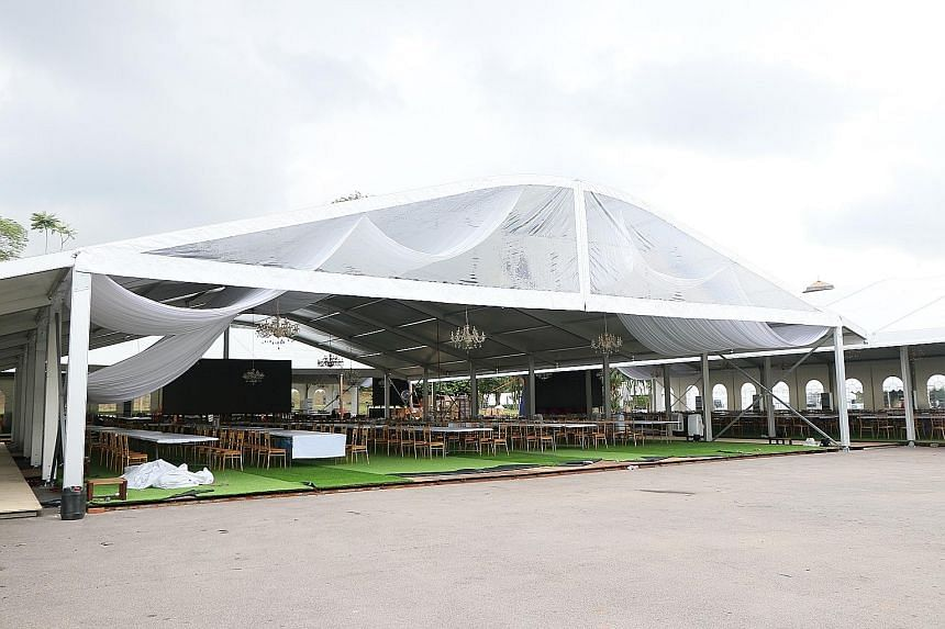 White canopies erected outside Istana Besar in Johor Baru, where guests can watch the royal wedding ceremony on giant screens.