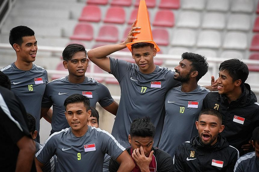 A light-hearted moment as team-mates put a traffic cone on birthday boy Irfan Fandi's head after a training session yesterday. Singapore will meet Myanmar today in the SEA Games.