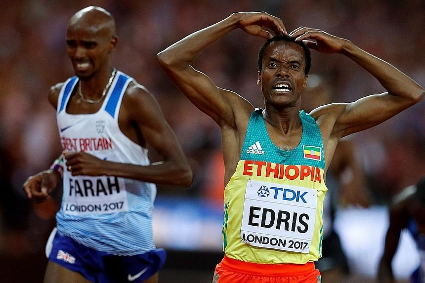 Muktar Edris of Ethiopia celebrates winning the 5,000m final ahead of Mo Farah by performing the 'Mobot', a pose that is associated with the long distance star from Britain.