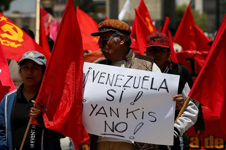 "A protester with a placard, which reads ""Yes, to Venezuela! No, to Yankees!"", in support of President Nicolas Maduro in Mexico City on Saturday. US President Donald Trump said last Friday that military intervention in Venezuela was an option."