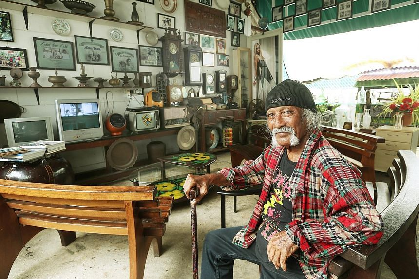 Studio caretaker Jumahat Abu Bakar with some of the mementoes that take visitors back to the heyday of the Malay film industry. He was thrilled to see the Jalan Ampas studios packed with people yesterday, with the Jejak Warisan tour attracting over 1