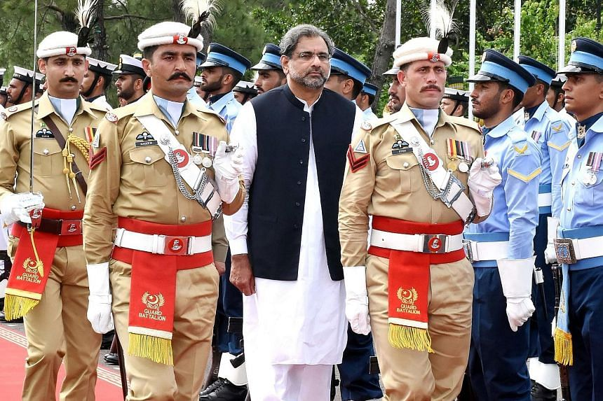 A Press Information Department photo released on Aug 3 shows Pakistani Prime Minister Shahid Khaqan Abbasi reviewing the honour guard during a welcome ceremony at Prime Minister House in Islamabad. Though he is loyal to ousted Prime Minister Nawaz Sh