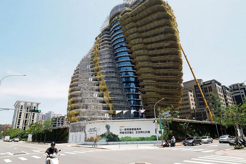 The Tao Zhu Yin Yuan apartment block in Taipei's Xinyi district is a green building that conserves energy, recycles rainwater and sucks up carbon dioxide emissions. The twist ensures that all 40 apartments will get sunshine. The building will be comp