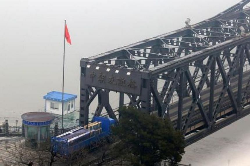 This file picture shows a Chinese truck crosses the Yalu Bridge on its way to the North Korean town of Sinuiju.