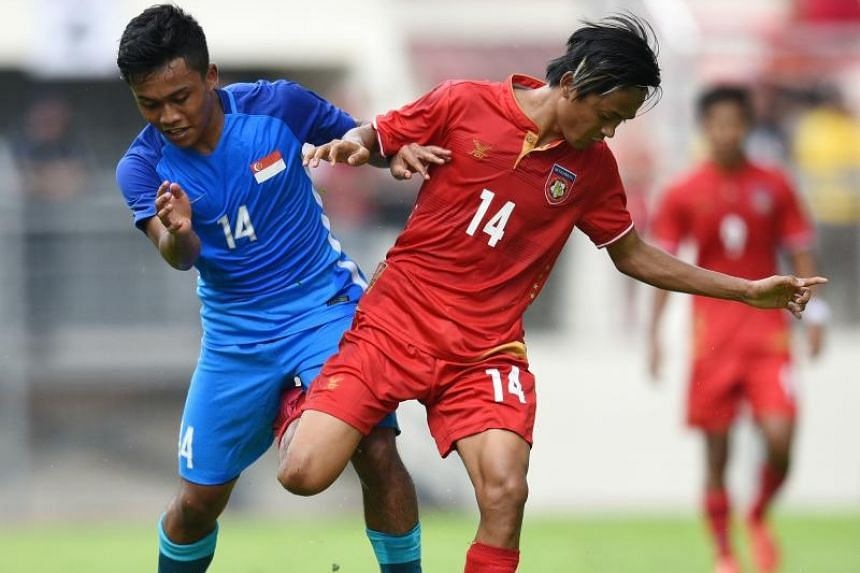 Young Lions forward Muhammad Hami Syahin tussling with Myanmar midfielder Yan Naing Oo during their Group A football match at the KL Games today (Aug 14).