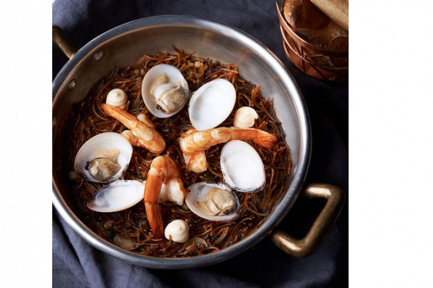 Spanish fideua – short noodles roasted and then resuscitated in a seafood broth, with a handful of fresh clams and shrimp scattered on top from Restaurant Gaig.