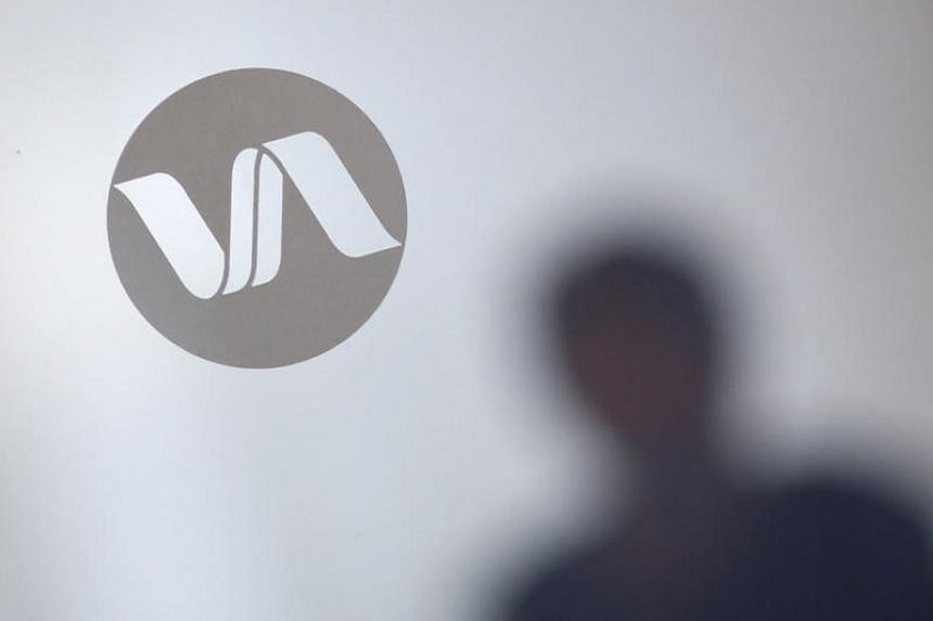 A file picture of Noble Group signage is pictured through a glass door at office in Singapore. PHOTO: REUTERS