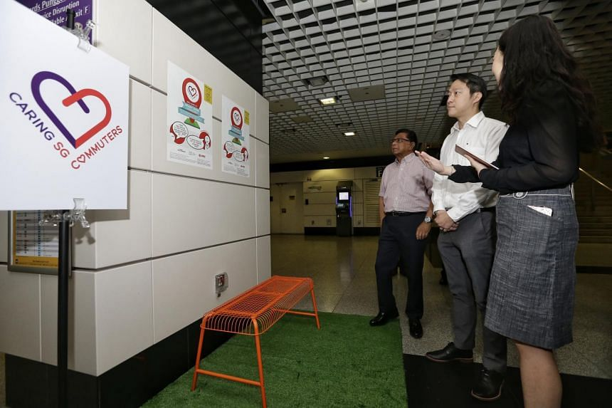 Senior Minister of State for Health and Transport Lam Pin Min (centre), with Mr Richard Magnus, chairman of the Public Transport Council, looking at the Heart Zone on Aug 14, 2017.