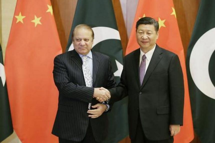 Pakistani Prime Minister Nawaz Sharif (left) meets Chinese President Xi Jinping ahead of the Belt and Road Forum in Beijing, China on May 13, 2017.