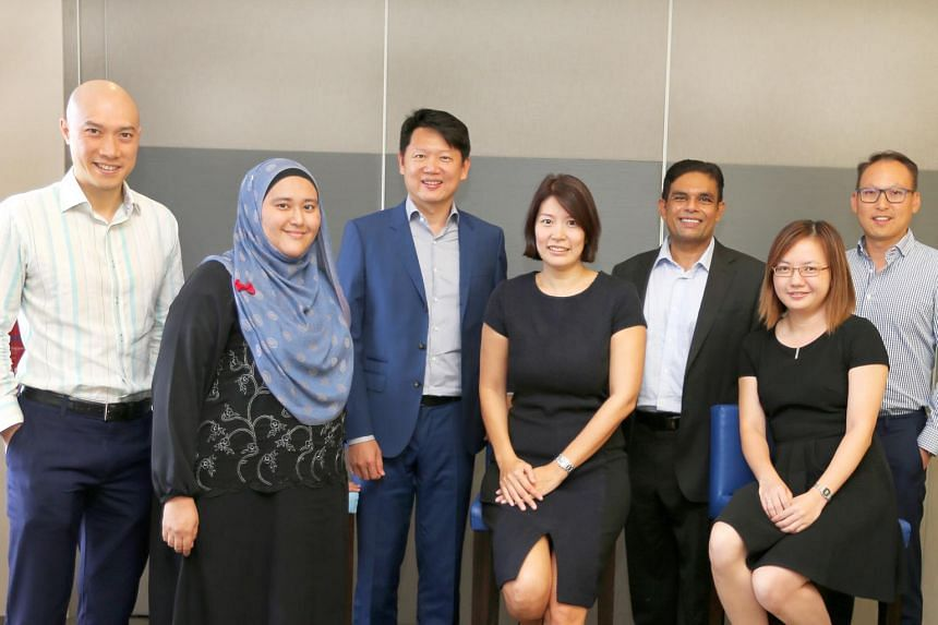 (From left) ROHI board member Mr Mark Wong, case worker Ms Sharifah Alhabshee, board member and founder Mr Danny Yong, executive director Ms Sharmin Foo, board member Mr Abdul Jabbar Bin Karam , case worker Ms Eileen Tay and board member Mr Kenneth K