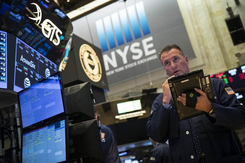 A trader works on the floor of the New York Stock Exchange (NYSE) ahead of the closing bell.