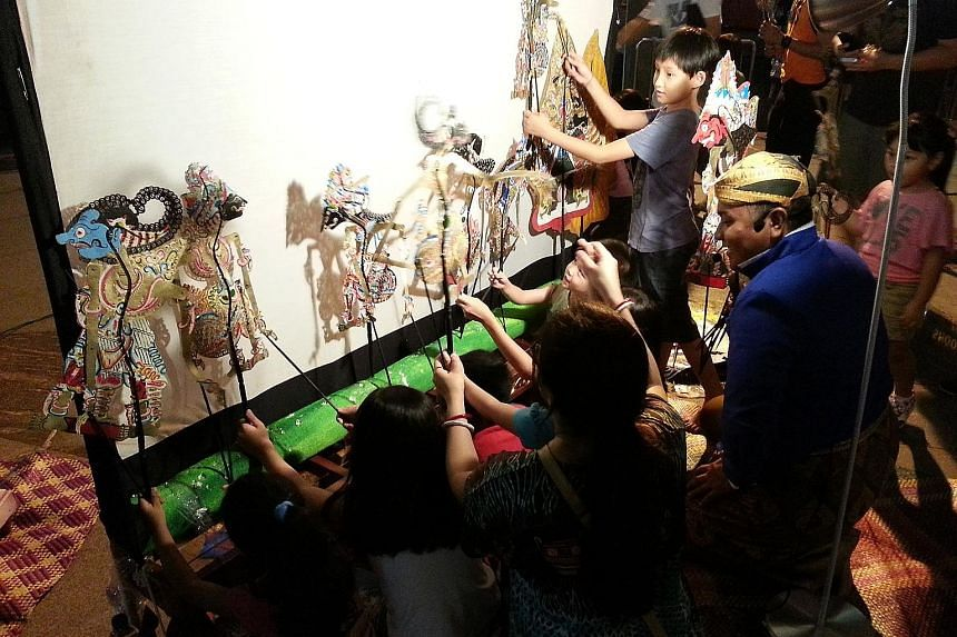 At Sri Warisan's performance in Aliwal Street, audience members can play with the performing arts troupe's shadow puppets or those they make themselves at a workshop.