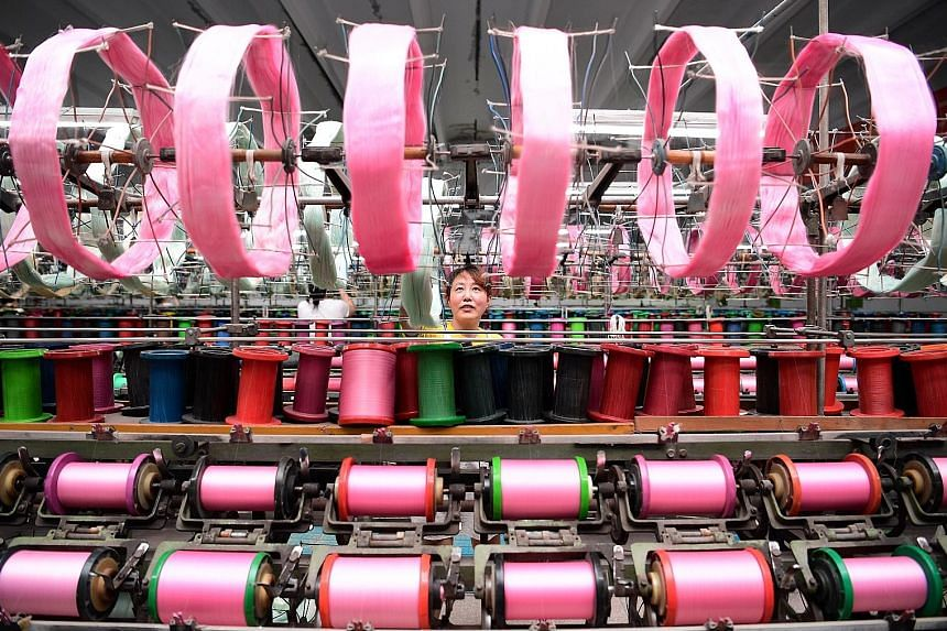 A silk factory in Nantong in China's Jiangsu province. China's factory output rose 6.4 per cent last month from a year earlier, the slowest pace since January, according to data from the National Bureau of Statistics yesterday.