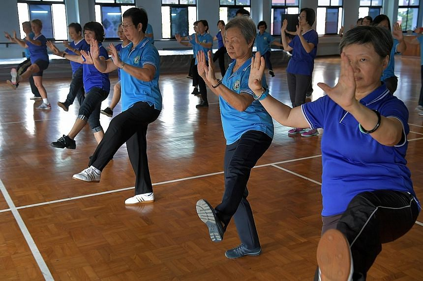 Regulars at a class held by taiji instructor Jennifer Chung at a badminton court in Bishan.