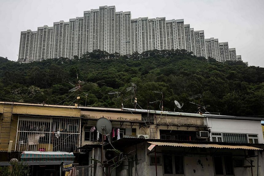 Prices at Wonderland Villas hilltop residential complex in the Kwai Fong district of Hong Kong have risen, waned and risen again. Home prices in the city have shot ever higher, bouncing back from the global financial crisis and bouts of government co